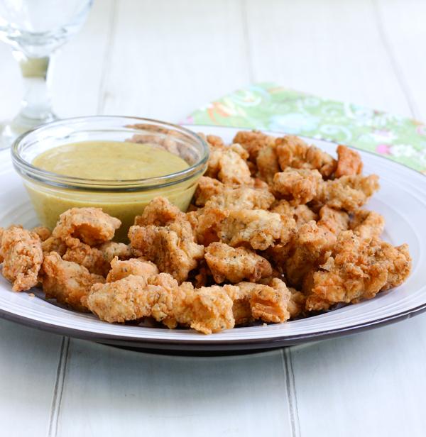 Dedos de pollo al horno con manzanas fritas